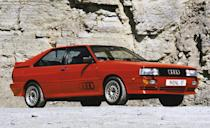 <p>A blocky, blister-fendered hatchback in its most basic iteration—and a winged, widened 591-hp rally sled in its most extreme S1 form—the Audi Quattro proved that world-beating performance needn't be packaged in something flat enough to drive under a semi. Nor, for that matter, did it require eight- or 12-cylinder power. Just five turbocharged cylinders mated to an all-wheel-drive system that gave the car its name proved good enough to make it a dominant force on the early 1980s World Rally scene in the deft hands of greats such as Michèle Mouton, Stig Blomqvist, Hannu Mikkola, and Walter Röhrl. </p>