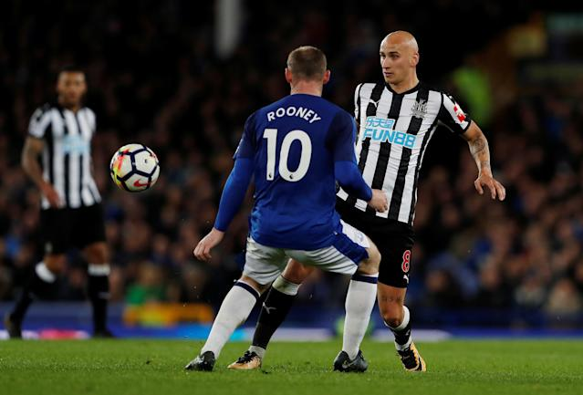 "Soccer Football - Premier League - Everton v Newcastle United - Goodison Park, Liverpool, Britain - April 23, 2018 Newcastle United's Jonjo Shelvey in action with Everton's Wayne Rooney Action Images via Reuters/Lee Smith EDITORIAL USE ONLY. No use with unauthorized audio, video, data, fixture lists, club/league logos or ""live"" services. Online in-match use limited to 75 images, no video emulation. No use in betting, games or single club/league/player publications. Please contact your account representative for further details."