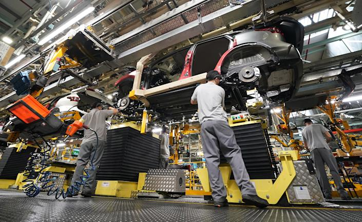 Workers on the production line at Nissan's factory in Sunderland, UK. Photo: Owen Humphreys/PA via Getty Images
