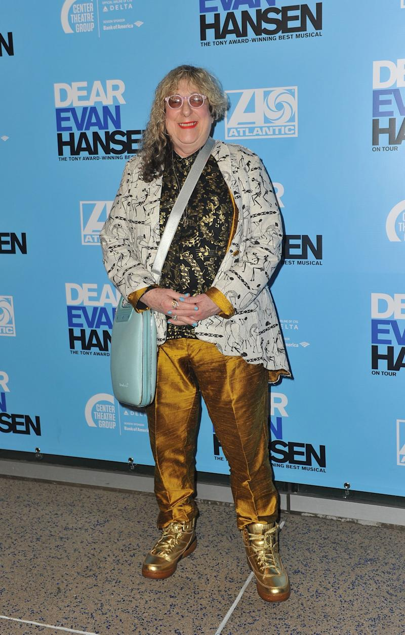 Allee Willis poses at Dear Evan Hansen premiere wearing a sequined top and gold pants