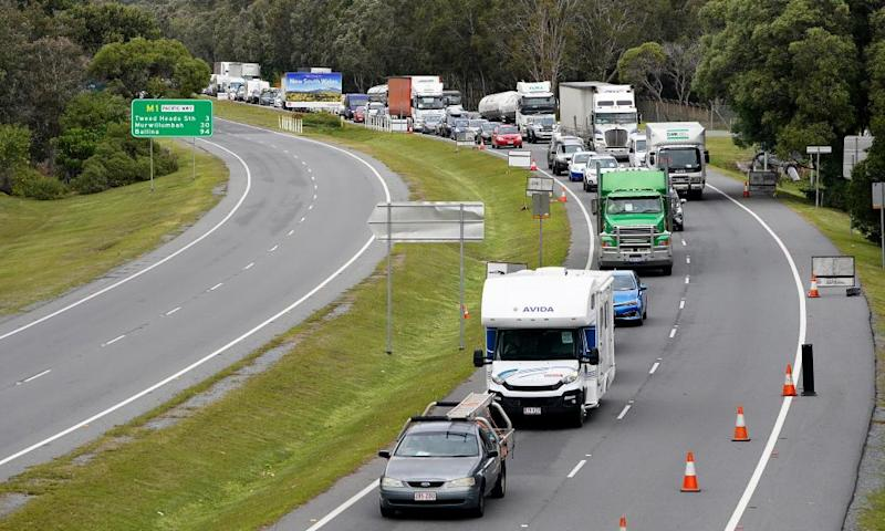 Motorists are seen approaching a checkpoint at Coolangatta on the Queensland/New South Wales border.