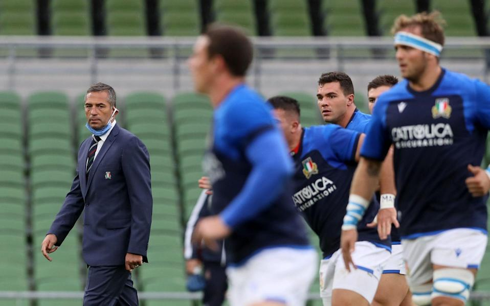 Italy's Head Coach Franco Smith (L) watches his players warm up during the Six Nations international rugby union match between Ireland and Italy at the Aviva Stadium in Dublin, on October 24, 2020. - AFP