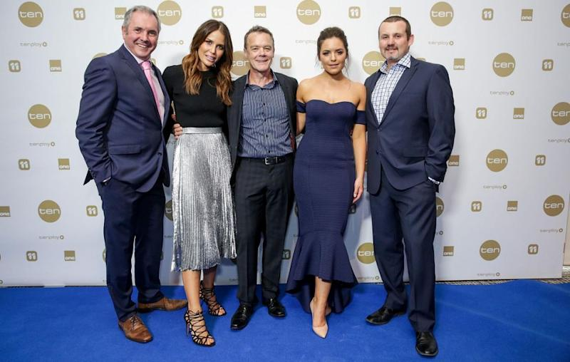 The show's future in Britain is said to be under jeopardy. Over the years the cast has changed - Alan pictured here with long-standing cast members Stefan Dennis and Ryan Moloney as well as more recent additions Jodi Anasta and Olympia Valance. Source: Getty