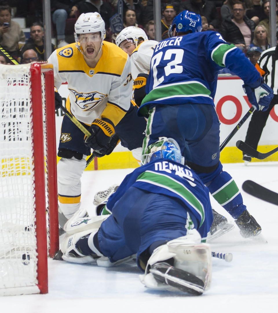 Nashville Predators left wing Viktor Arvidsson (33) reacts to teammate Calle Jarnkrok's goal past Vancouver Canucks goaltender Thatcher Demko (35) during the second period of an NHL hockey game Tuesday, Nov. 12, 2019, in Vancouver, British Columbia. (Jonathan Hayward/The Canadian Press via AP)