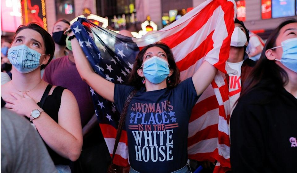 Women in Times Square, New York, watch as Kamala Harris gives her victory speech on Saturday. Photo: Reuters