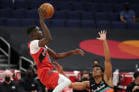 Toronto Raptors forward Chris Boucher (25) shoots over San Antonio Spurs forward Keldon Johnson (3) during the first half of an NBA basketball game Wednesday, April 14, 2021, in Tampa, Fla. (AP Photo/Chris O'Meara)