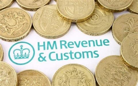 Pound coins on a HMRC letter