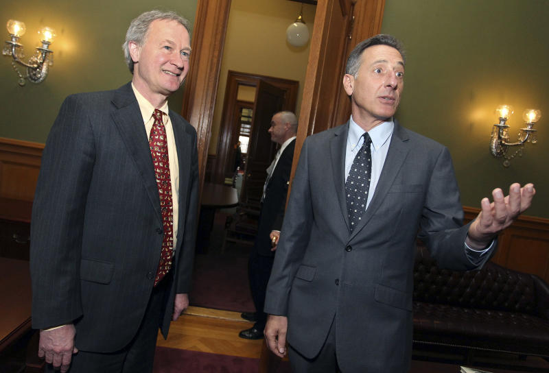 FILE - In this March 31, 2011 file photo, Rhode Island Gov. Lincoln Chafee, left, and Vermont Gov. Peter Shumlin, right, talk before a news conference on gay marriage at the Statehouse in Providence, R.I.  Shumlin, head of the Democratic Governors Association, said in an interview with The Associated Press Wednesday, March 6, 2013, he is encouraging Chafee, an independent, to become a Democrat. (AP Photo/Stew Milne, File)