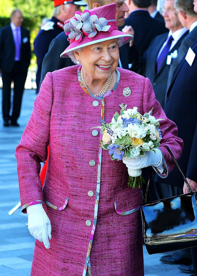 """Hats off to the Queen! The monarch, 91, stepped up her hat game this week with her prettiest topper yet. During a royal appearance in Scotland on July 5, <a href=""""http://people.com/tag/queen-elizabeth/"""">Queen Elizabeth</a> wore a magenta hat with delicate silk flowers crafted by her go-to milliner, Rachel Trevor-Morgan.  Aside from her <a href=""""http://people.com/royals/princess-charlottes-christening-photos-4-important-questions/"""">trusty purse</a>, matching hats are the royal's constant accessory, and in recent weeks they've been more beautiful and colorful than ever before. Click through for some of her best looks."""