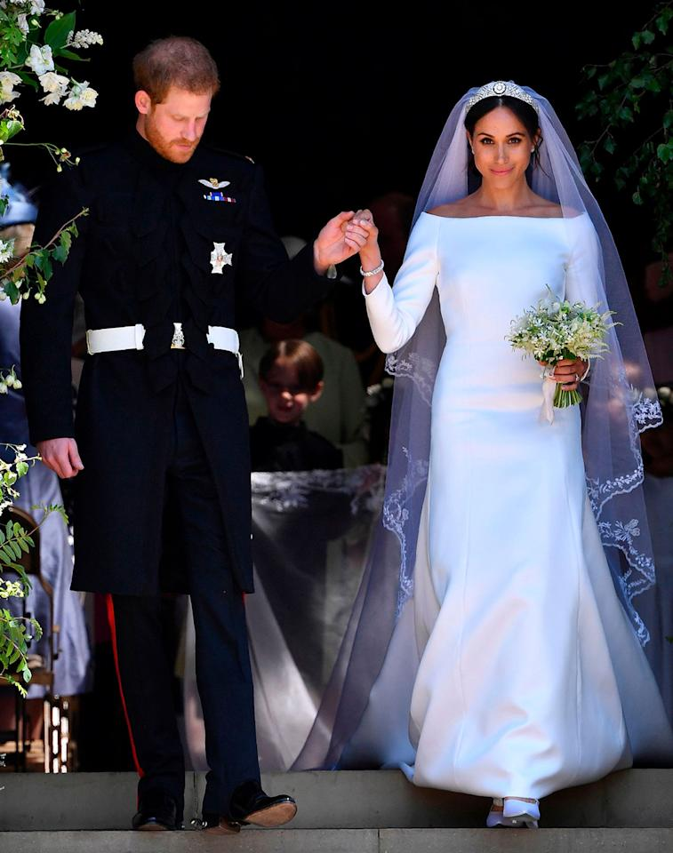 <p>Meghan Markle wears an off-the-shoulder white gown by Givenchy for her royal wedding to Prince Harry. (Photo: Getty images) </p>