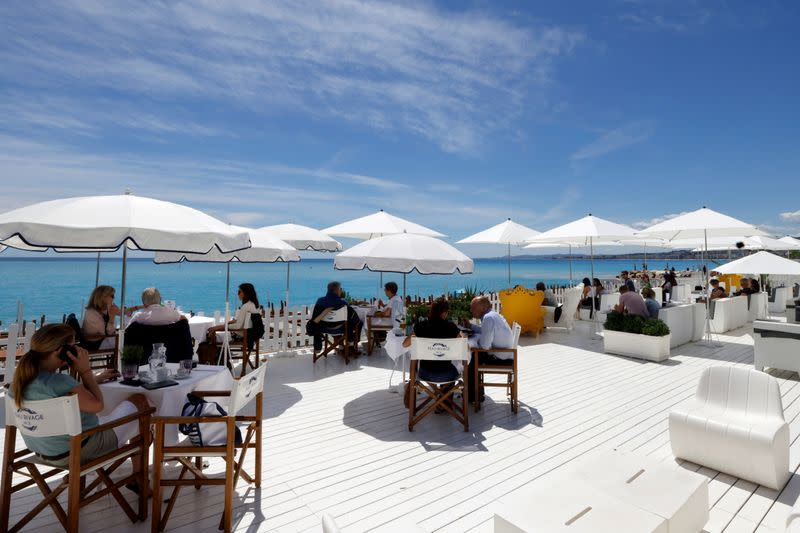 FILE PHOTO: Restaurants welcome customers onto terraces in Nice as France lifts more restrictions