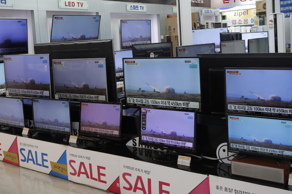 "TV screens show a news program reporting about North Korea's missiles with file footage at an electronic shop in Seoul, South Korea, Thursday, March 25, 2021. North Korea on Thursday test-fired its first ballistic missiles since President Joe Biden took office, as it expands its military capabilities and increases pressure on Washington while nuclear negotiations remain stalled. The Korean letters on TVs read: ""Japan, North missile flew about 450 kilometers."" (AP Photo/Lee Jin-man)"