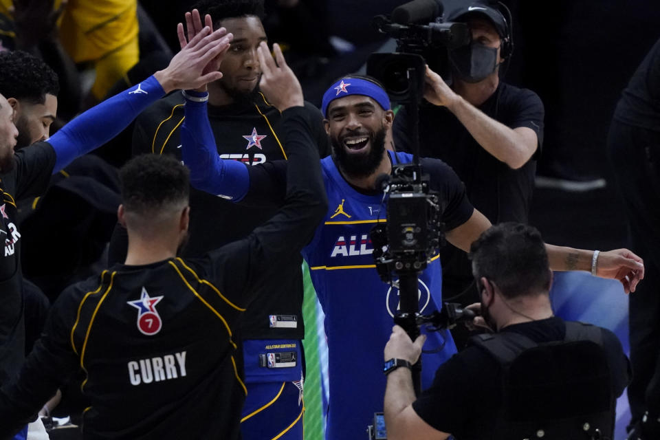 Golden State Warriors guard Stephen Curry and Utah Jazz guard Mike Conley celebrate during the first half of basketball's NBA All-Star Game in Atlanta, Sunday, March 7, 2021. (AP Photo/Brynn Anderson)