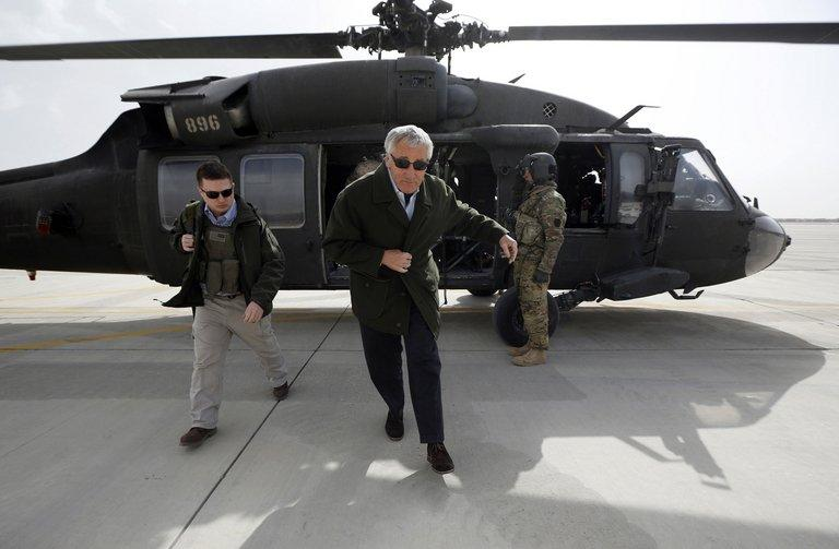 US Defense Secretary Chuck Hage steps off a military helicopter at Bagram airfield in Afghanistan on March 9, 2013