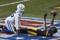 Pittsburgh Steelers wide receiver Diontae Johnson (18) celebrates in the end zone in front of Indianapolis Colts cornerback Rock Ya-Sin (26) after making a touchdown during the second half of an NFL football game, Sunday, Dec. 27, 2020, in Pittsburgh. (AP Photo/Don Wright)