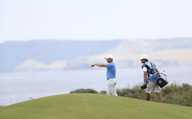 Northern Ireland's Rory McIlroy gestures as he looks down the 5th hole during a practice round ahead of the start of the British Open golf championships at Royal Portrush in Northern Ireland, Tuesday, July 16, 2019. The British Open starts Thursday. (AP Photo/Peter Morrison)