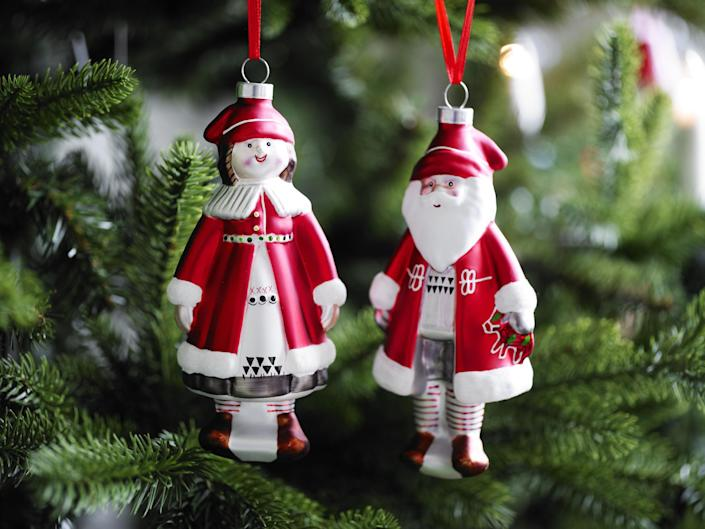 This photo provided by Ikea shows Heart and Folk Santas, folk art-y ornaments, rendered in any material, that are at the heart of a traditional Christmas. Following the general trend in home decor, holiday trim and accessories this year are a mix of eclectic and traditional colors and styles. Style watchers say we're approaching the holidays with a more open mind, and decor has never been more expansive in terms of what works. (AP Photo/Ikea)