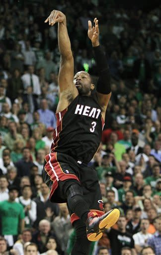 Miami Heat guard Dwyane Wade (3) takes a final shot against the Boston Celtics during overtime of Game 4 in their NBA basketball Eastern Conference finals playoff series in Boston, Sunday, June 3, 2012. Boston won 93-91. (AP Photo/Elise Amendola)