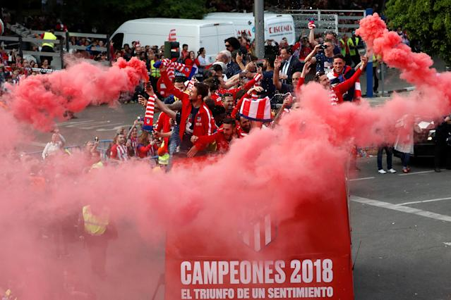 Soccer Football - Atletico Madrid Celebrate Winning The Europa League - Neptuno Square, Madrid, Spain - May 18, 2018 Atletico Madrid players on an open top bus during the celebrations REUTERS/Juan Medina
