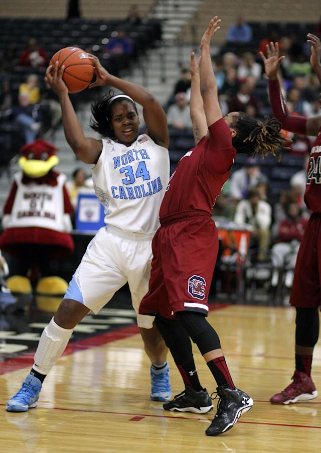 North Carolina's Xlina McDaniel (34) pulls down a rebound against South Carolina during an NCAA college basketball game in Myrtle Beach, S.C., Wednesday, Dec. 18, 2013. (AP Photo/Willis Glassgow)