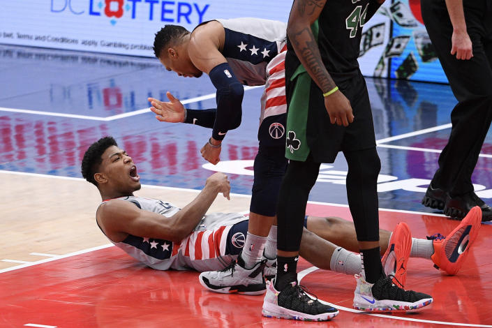 Washington Wizards forward Rui Hachimura (8), of Japan, reacts with guard Russell Westbrook (4) after he scored and was fouled during the first half of an NBA basketball game against the Boston Celtics, Sunday, Feb. 14, 2021, in Washington. (AP Photo/Nick Wass)