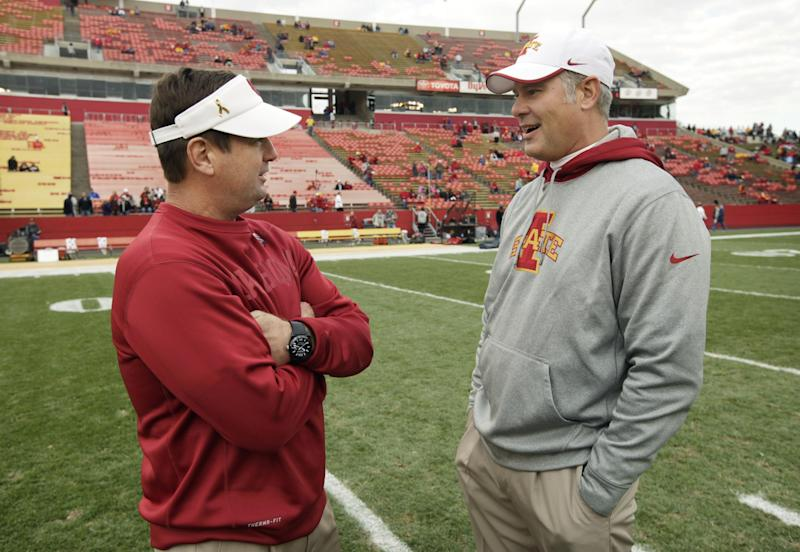 Oklahoma head coach Bob Stoops, left, talks with Iowa State head coach Paul Rhoads before an NCAA college football game, Saturday, Nov. 3, 2012, in Ames, Iowa. (AP Photo/Charlie Neibergall)