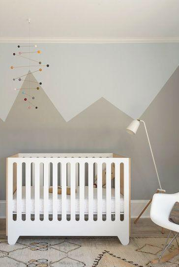 """<p>Just because it's a nursery doesn't mean it needs to be super whimsical and soft. <a href=""""https://www.studiodb.com/"""" rel=""""nofollow noopener"""" target=""""_blank"""" data-ylk=""""slk:Studio DB"""" class=""""link rapid-noclick-resp"""">Studio DB</a> chose a more angular approach with a graphic wall mural and modern geometric mobile. The colorful details and layers of shapes make it appropriately playful for a nursery.</p>"""