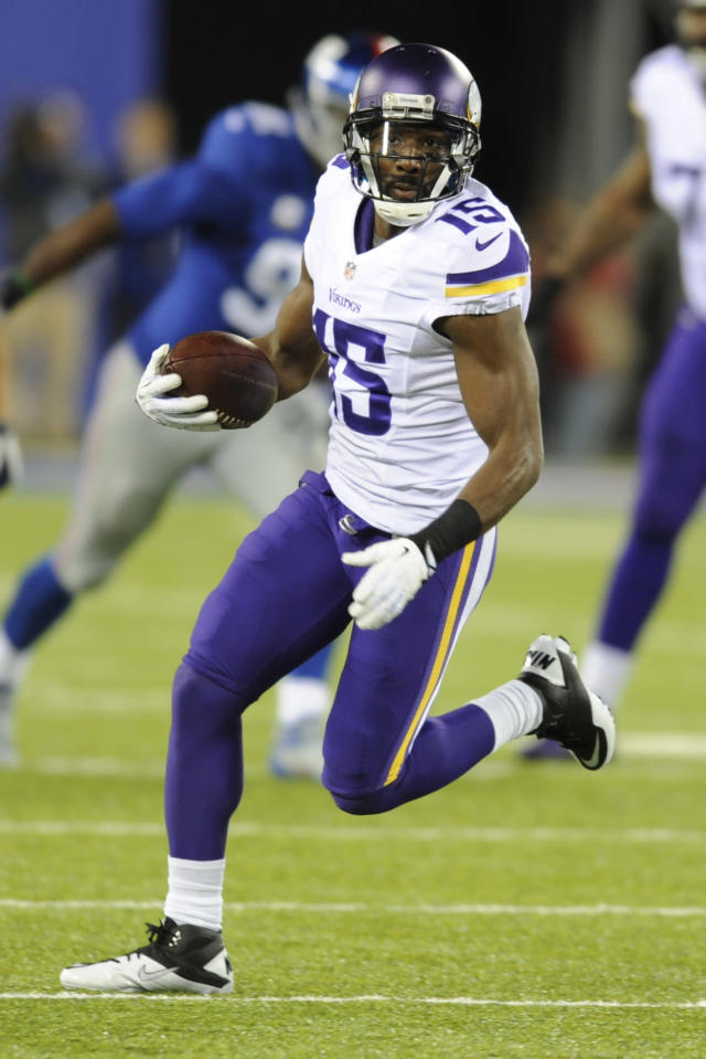 FILE - In this Oct. 21, 2013, file photo, Minnesota Vikings wide receiver Greg Jennings (15) runs during the second half of an NFL football game against the New York Giants in East Rutherford, N.J. The Vikings receiver spent seven seasons in Green Bay before signing with the NFC North archrivals in the offseason. He's about to square off for the first time against his old team when the Packers visit the Vikings on Sunday night. (AP Photo/Bill Kostroun, File)
