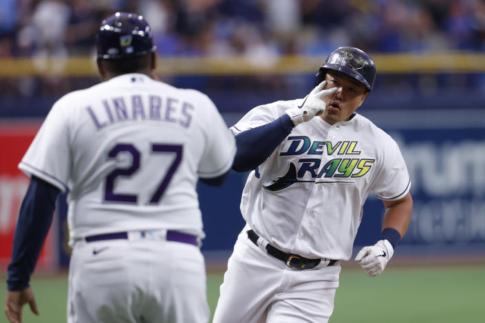 Tampa Bay Rays' Ji-Man Choi celebrates with third base coach Rodney Linares after hitting a home run against the Boston Red Sox during the first inning of a baseball game Saturday, July 31, 2021, in St. Petersburg, Fla. (AP Photo/Scott Audette)