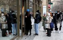 Customers at re-opened shops as restrictions ease in Prague