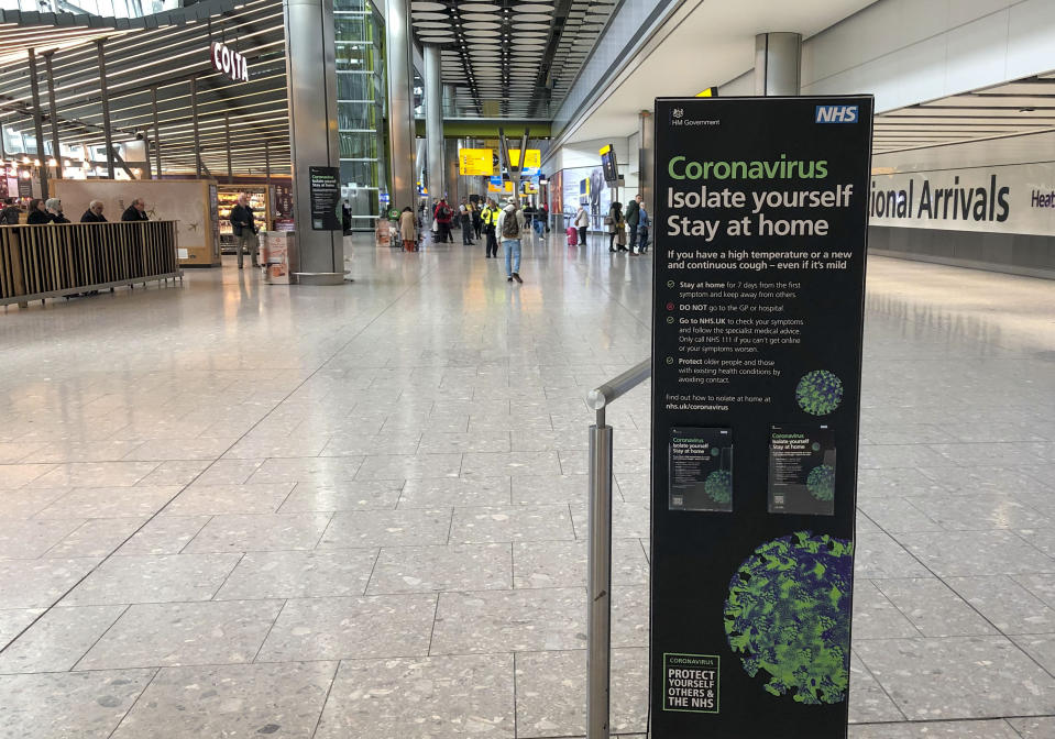A sign in the empty arrivals area of Terminal 5 of Heathrow Airport telling passengers what to do with Coronavirus as Britons have been advised against non-essential travel to anywhere in the world as the coronavirus crisis closed borders around the globe. (Photo by Steve Parsons/PA Images via Getty Images)