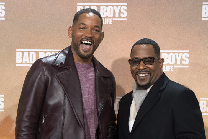 """Actors Will Smith, left, and Martin Lawrence pose for the media on the red carpet, for the German premiere of """"Bad Boys For Life"""", in Berlin, Tuesday, Jan. 7, 2020. (Jorg Carstensen/dpa via AP)"""