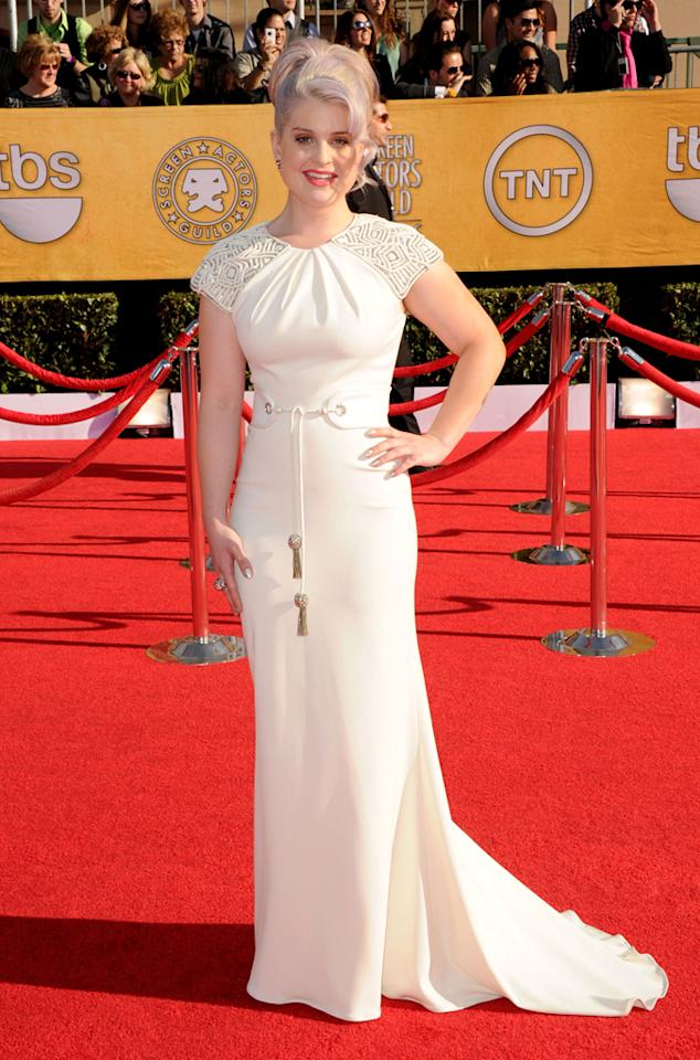 Kelly Osbourne arrives at the 18th Annual Screen Actors Guild Awards at The Shrine Auditorium in Los Angeles, California.