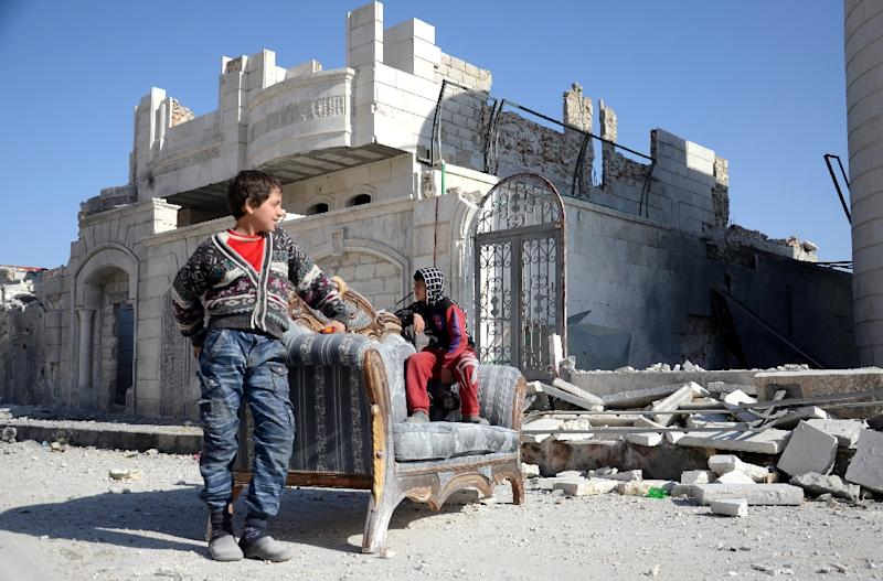 Syrian children outside a destroyed building in the northwestern border town of al-Bab on February 25, 2017 after Turkish-backed rebels announced the recapture of the town from the Islamic State (IS) group earlier in the week (AFP Photo/Nazeer al-Khatib)