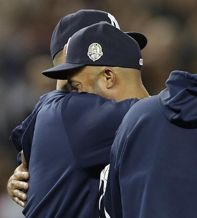 New York Yankees relief pitcher Mariano Rivera, right, embraces Yankees pitcher Andy Pettitte, who came out to the mound after Rivera's final pitching appearance in a baseball game at Yankee Stadium, against the Tampa Bay Rays on Thursday, Sept. 26, 2013, in New York. Both players are retiring after the season, which ends for the Yankees on Sunday in Houston. The Rays won 4-0. (AP Photo/Kathy Willens)