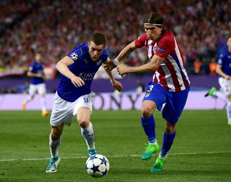 Leicester City's forward Jamie Vardy (L) vies with Atletico Madrid's defender Filipe Luis during the UEFA Champions League quarter final first leg football match April 12, 2017