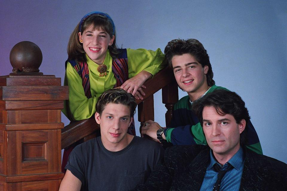 """<p>The original pilot for the show had Mayim Bialik's character Blossom as a kid sister side character with the main focus being on <a href=""""https://www.redbookmag.com/love-sex/relationships/a18370386/identical-brothers-proposed-to-twin-sisters/"""" rel=""""nofollow noopener"""" target=""""_blank"""" data-ylk=""""slk:her older brother"""" class=""""link rapid-noclick-resp"""">her older brother</a>. But a female NBC exec suggested to creator Don Reo that he switch it up and focus on the sister instead.</p>"""