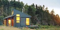 """<p>This 550-square-foot Maine cottage has <a href=""""https://go.redirectingat.com?id=74968X1596630&url=http%3A%2F%2Fwww.homedepot.com%2Fp%2FGrape-Solar-400-Watt-Off-Grid-Solar-Panel-Kit-GS-400-KIT%2F203505963&sref=https%3A%2F%2Fwww.countryliving.com%2Fhome-design%2Fg1887%2Ftiny-house%2F"""" rel=""""nofollow noopener"""" target=""""_blank"""" data-ylk=""""slk:solar panels"""" class=""""link rapid-noclick-resp"""">solar panels</a> on the southeast-facing porch to collect energy (<a href=""""https://go.redirectingat.com?id=74968X1596630&url=https%3A%2F%2Fwww.walmart.com%2Fip%2FAPC-Back-UPS-Pro-1500VA-Uninterruptible-Power-Supply-External-Battery-Pack-for-BR1500G-Model-UPS-BR24BPG%2F23020903%3Fwmlspartner%3Dwlpa%26selectedSellerId%3D0%26adid%3D22222222227016460169%26wl1%3Dg%26wl2%3Dc%26wl3%3D40881691712%26wl4%3Dpla-78811919552%26wl5%3D9073477%26wl9%3Dpla_with_promotion%26wl10%3D8175035%26wl11%3Donline%26wl12%3D23020903%26veh%3Dsem&sref=https%3A%2F%2Fwww.countryliving.com%2Fhome-design%2Fg1887%2Ftiny-house%2F"""" rel=""""nofollow noopener"""" target=""""_blank"""" data-ylk=""""slk:auxiliary batteries"""" class=""""link rapid-noclick-resp"""">auxiliary batteries</a> can store at least a week's worth) to power the refrigerator and heat shower water. A <a href=""""https://go.redirectingat.com?id=74968X1596630&url=http%3A%2F%2Fwww.homedepot.com%2Fp%2FPleasant-Hearth-1-200-sq-ft-EPA-Certified-Wood-Burning-Stove-WS-2417%2F205718882&sref=https%3A%2F%2Fwww.countryliving.com%2Fhome-design%2Fg1887%2Ftiny-house%2F"""" rel=""""nofollow noopener"""" target=""""_blank"""" data-ylk=""""slk:wood stove"""" class=""""link rapid-noclick-resp"""">wood stove</a>, anchored by a hearth made of local beach stones, radiates enough warmth for the entire building.</p><p><a class=""""link rapid-noclick-resp"""" href=""""https://www.countryliving.com/home-design/house-tours/a35775/daughter-builds-tiny-cottage-for-father/"""" rel=""""nofollow noopener"""" target=""""_blank"""" data-ylk=""""slk:SEE INSIDE"""">SEE INSIDE</a></p>"""