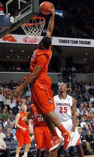 Clemson's Devin Booker (31) dunks over Virginia forward Akil Mitchell (25) during the first half of an NCAA college basketball game, Tuesday, Jan. 31, 2012, in Charlottesville, Va. (AP Photo/Andrew Shurtleff)