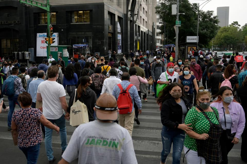 People walk in downtown in Mexico City on December 16, 2020, amid the COVID-19 pandemic. (Photo by ALFREDO ESTRELLA / AE / AFP) (Photo by ALFREDO ESTRELLA/AE/AFP via Getty Images)