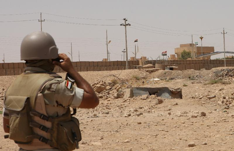 An Iraqi soldier is seen monitoring the Iraq-Syria point at Albu Kamal in 2012