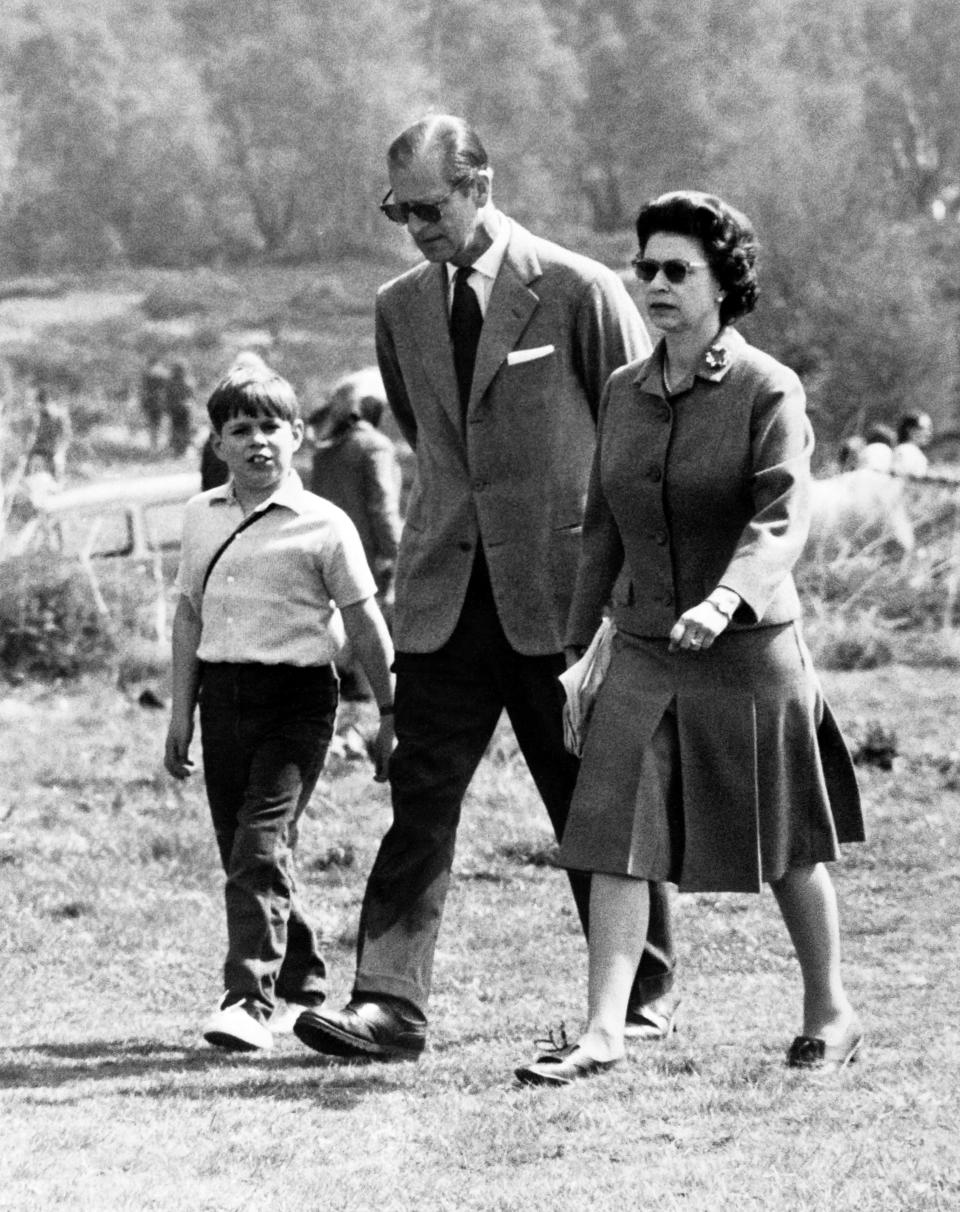 Prince Andrew with parents Queen Elizabeth II and Prince Philip in 1968, aged eight. (Getty Images)