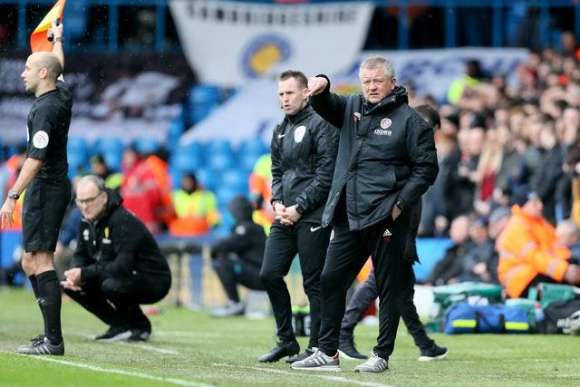 Sheffield United manager Chris Wilder, right, got the better of Leeds boss Marcelo Bielsa, second left, in the Championship