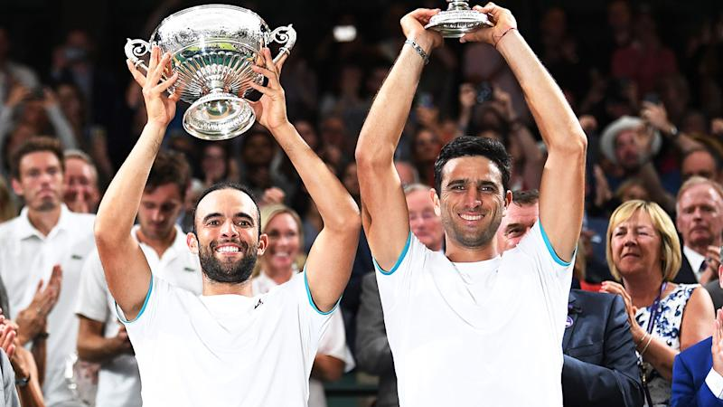 Juan Sebastian Cabal and Robert Farah, pictured here after winning Wimbledon in 2019.