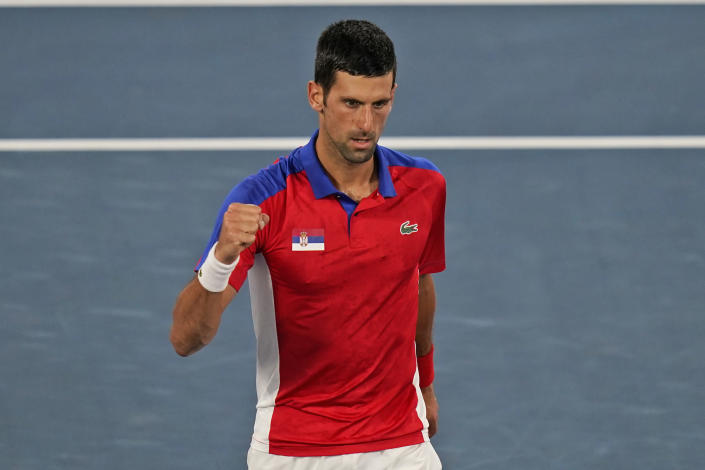 Novak Djokovic, of Serbia, reacts after winning the first set against Kei Nishikori, of Japan, during the quarterfinals of the tennis competition at the 2020 Summer Olympics, Thursday, July 29, 2021, in Tokyo, Japan. (AP Photo/Seth Wenig)