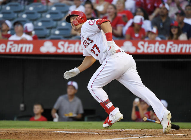 FILE - In this July 27, 2019, file photo, Los Angeles Angels' Mike Trout runs to first while watching his two-run home run during the first inning of the team's baseball game against the Baltimore Orioles in Anaheim, Calif. Trout won his third AL MVP Award on Thursday, Nov. 14, 2019. Trout got 17 of 30 first-place votes in balloting by the Baseball Writers Association of America. (AP Photo/Mark J. Terrill)