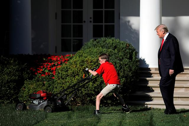 <p>President Donald Trump looks on as 11-years-old Frank Giaccio cuts the Rose Garden grass at the White House in Washington, U.S., September 15, 2017. Frank, who wrote a letter to Trump offering to mow the White House lawn, was invited to work for a day at the White House along the National Park Service staff. (Photo: Carlos Barria/Reuters) </p>