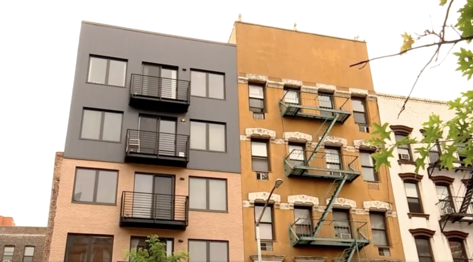 Two East Village apartment buildings in New York are pictured.