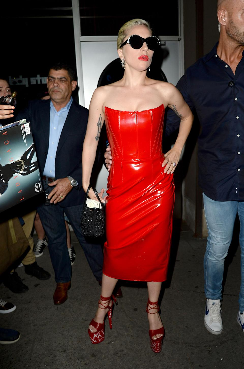 <p>Gaga then broke free of all monochrome by wearing a red PVC dress to end all PVC dresses. [Photo: Rex] </p>