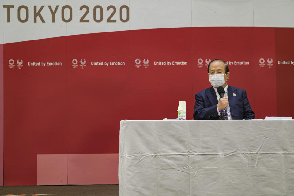 Toshio Muto, CEO of Tokyo 2020, attends a press conference after a Tokyo 2020 executive board meeting Monday, April 26, 2021 in Tokyo, Japan. (Nicolas Datiche/Pool Photo via AP)